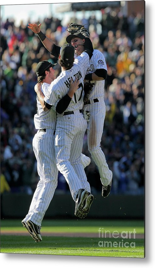 Celebration Metal Print featuring the photograph Todd Helton, Ian Stewart, and Troy Tulowitzki by Doug Pensinger