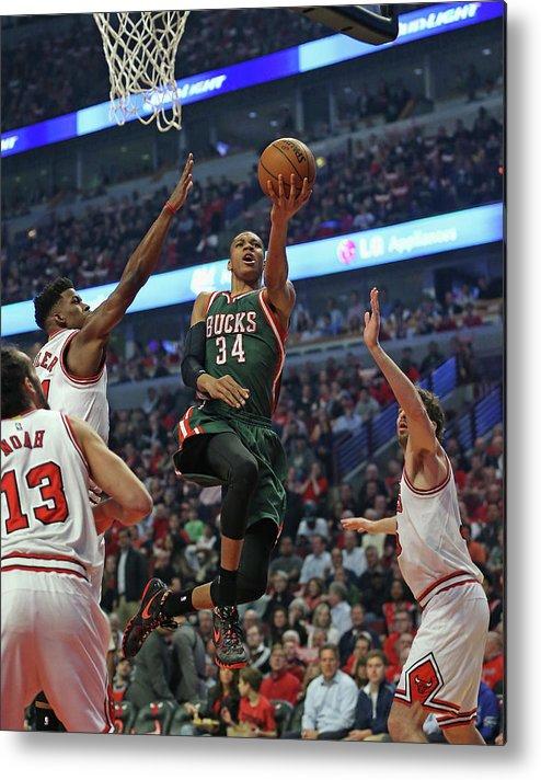 Playoffs Metal Print featuring the photograph Milwaukee Bucks V Chicago Bulls - Game by Jonathan Daniel