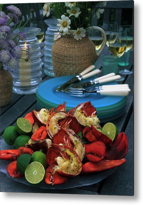 Still Life Metal Print featuring the photograph A Meal With Lobster And Limes by Romulo Yanes