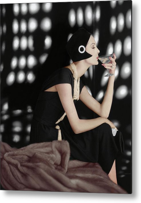 Fashion Metal Print featuring the photograph A Model Wearing A Branell Dress by Karen Radkai