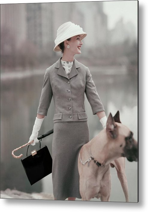 Fashion Metal Print featuring the photograph A Model Wearing A Gray Suit With A Dog by Karen Radkai