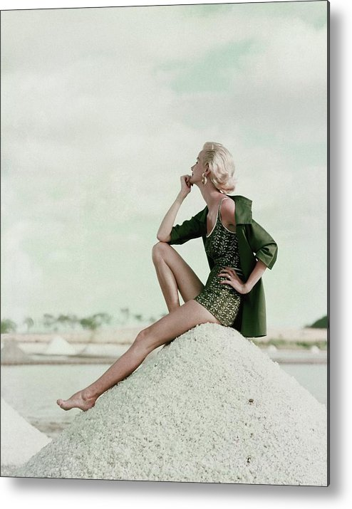Exterior Metal Print featuring the photograph A Model Wearing A Swimsuit And Jacket by Leombruno-Bodi