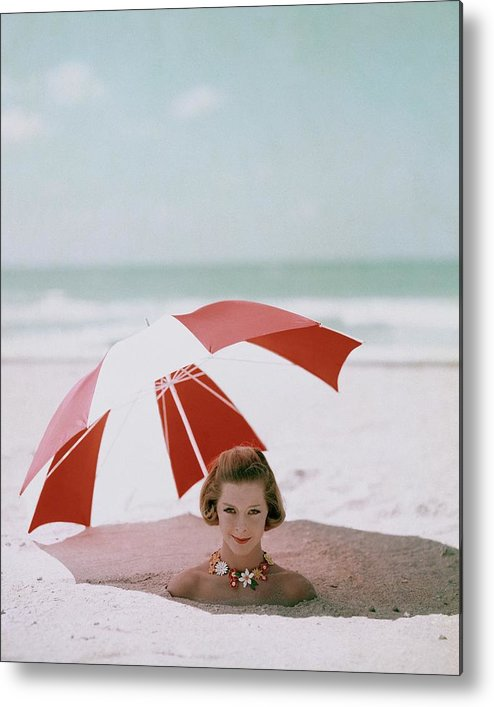 Beauty Metal Print featuring the photograph A Woman Buried In Sand At A Beach by Richard Rutledge