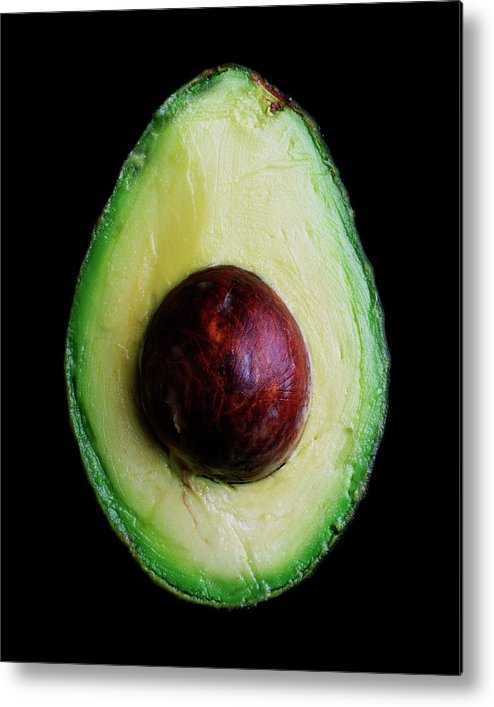 Fruits Metal Print featuring the photograph An Avocado by Romulo Yanes