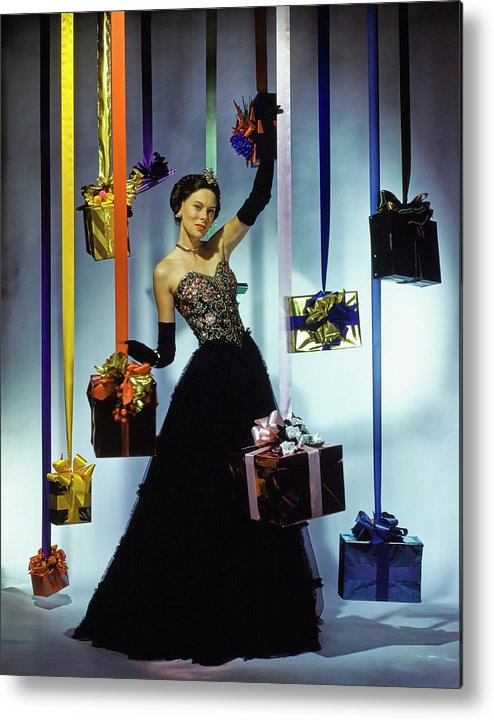 Accessories Metal Print featuring the photograph Model Wearing An Evening Gown Among Gifts by John Rawlings