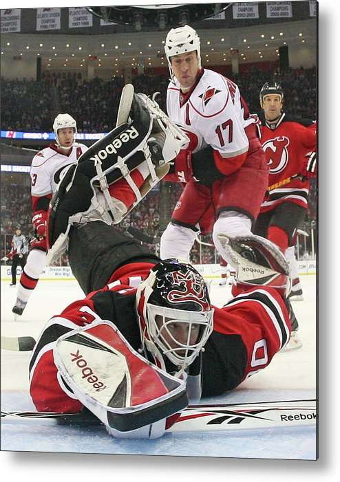 National Hockey League Metal Print featuring the photograph Carolina Hurricanes V New Jersey Devils by Bruce Bennett