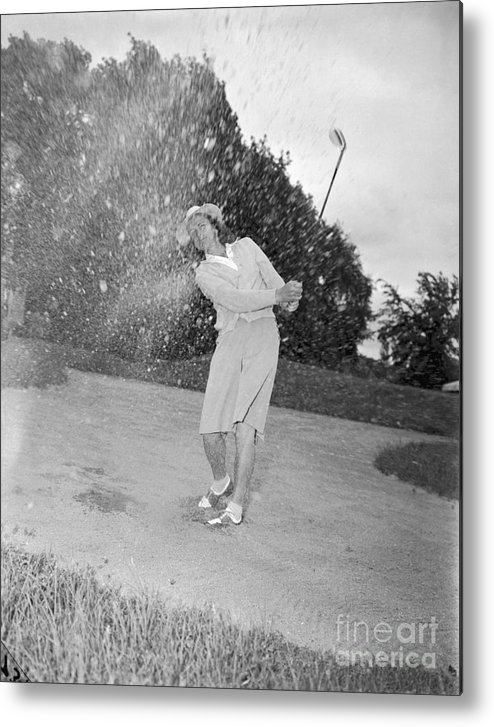 Sand Trap Metal Print featuring the photograph Babe Didrikson Spraying Sand With Golf by Bettmann