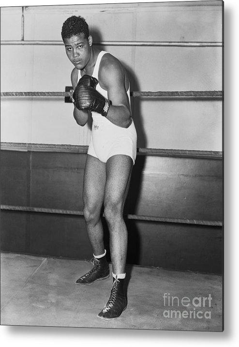 Young Men Metal Print featuring the photograph Boxing Champion Joe Louis by Bettmann
