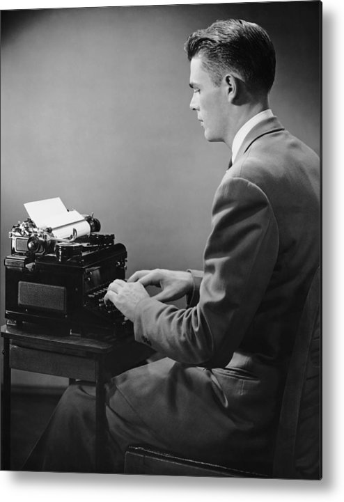 Three Quarter Length Metal Print featuring the photograph Businessman Inside Office Typing by George Marks