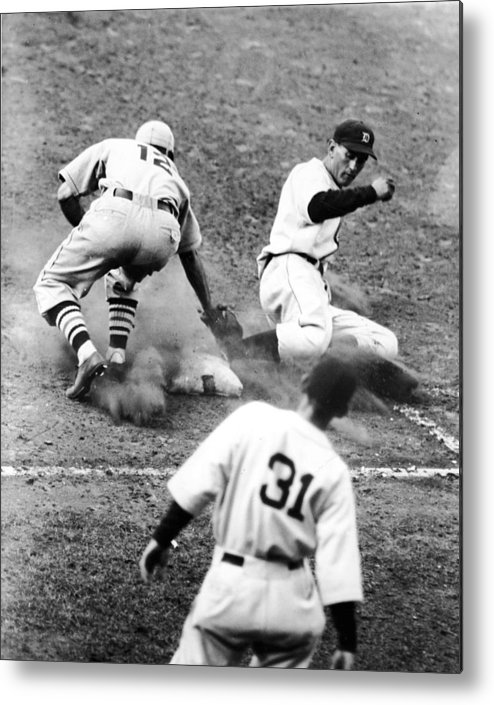 St. Louis Cardinals Metal Print featuring the photograph Charlie Gehringer Slides Into First Base by Fpg