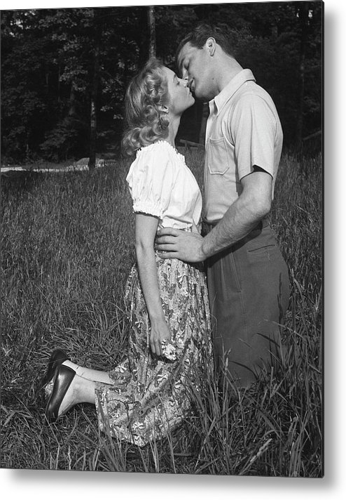 Heterosexual Couple Metal Print featuring the photograph Couple Kissing Outdoors by George Marks