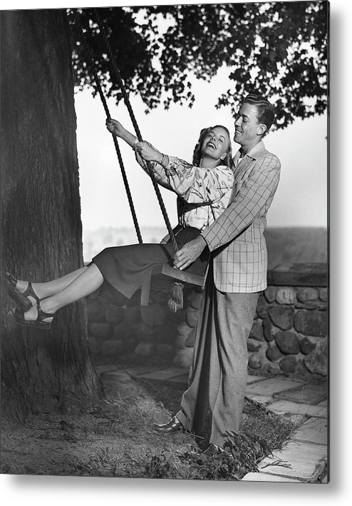 Heterosexual Couple Metal Print featuring the photograph Couple Wwoman On Swing by George Marks