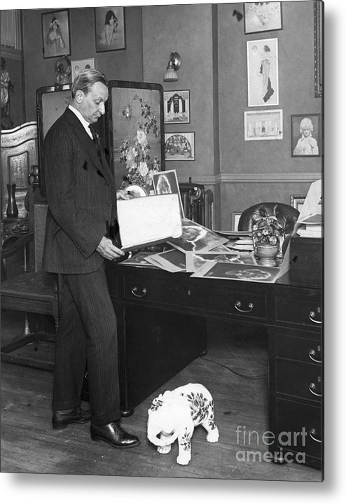 People Metal Print featuring the photograph Florenz Ziegfeld Looking At Photographs by Bettmann