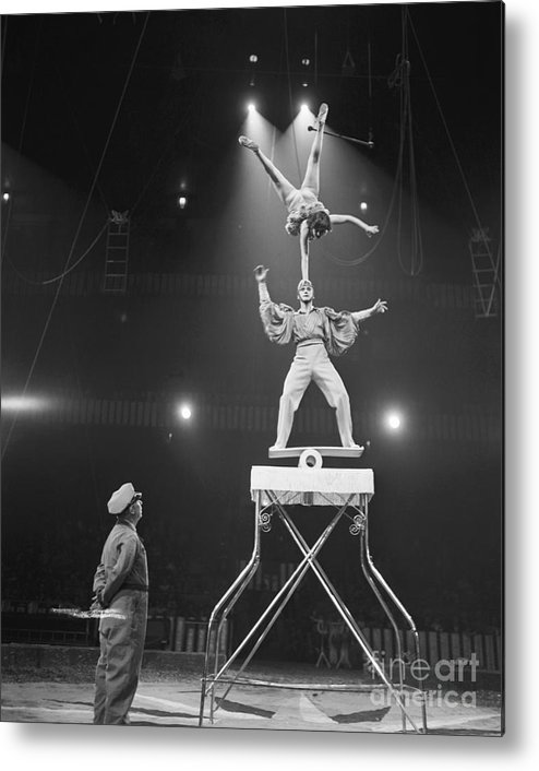 Mid Adult Women Metal Print featuring the photograph Italian Circus Performers Balancing by Bettmann