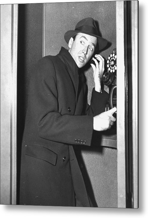 Jimmy Stewart Metal Print featuring the photograph James Stewart Stops To Make A Call At by New York Daily News Archive
