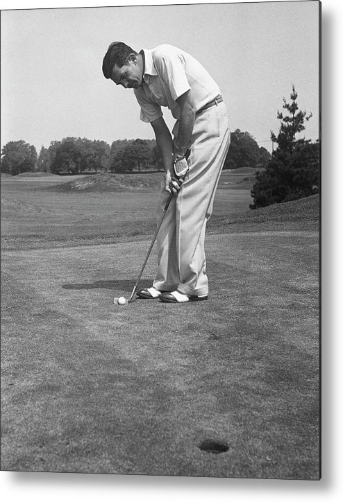 People Metal Print featuring the photograph Man Golfing by George Marks
