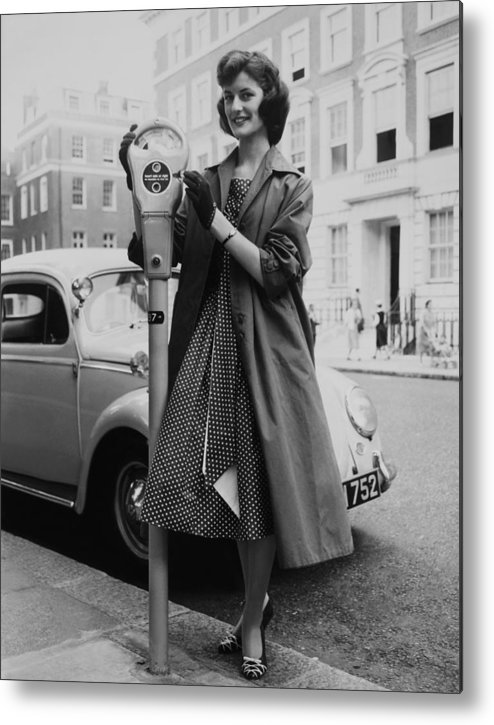 Coin Metal Print featuring the photograph Miss Lorraine Buist Putting A Coin Into by Keystone-france