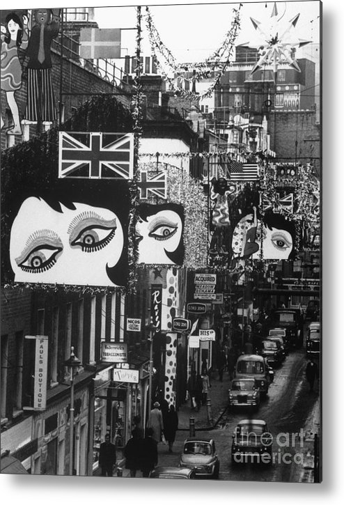 People Metal Print featuring the photograph Mod Christmas Decorations On Londons by Bettmann