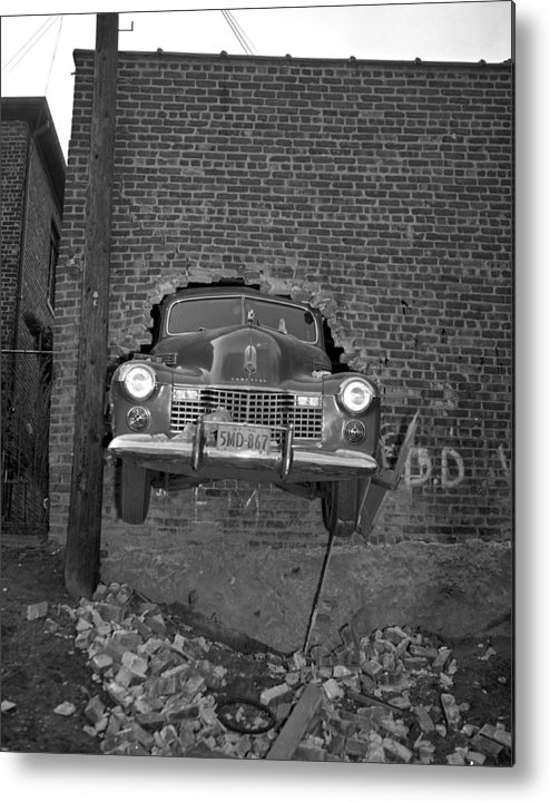 1940-1949 Metal Print featuring the photograph Nose Of A Nice New Cadillac Is Poked by New York Daily News Archive