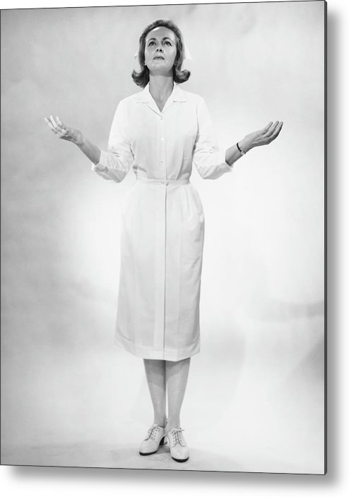 Human Arm Metal Print featuring the photograph Nurse Gesturing In Studio, B&w by George Marks
