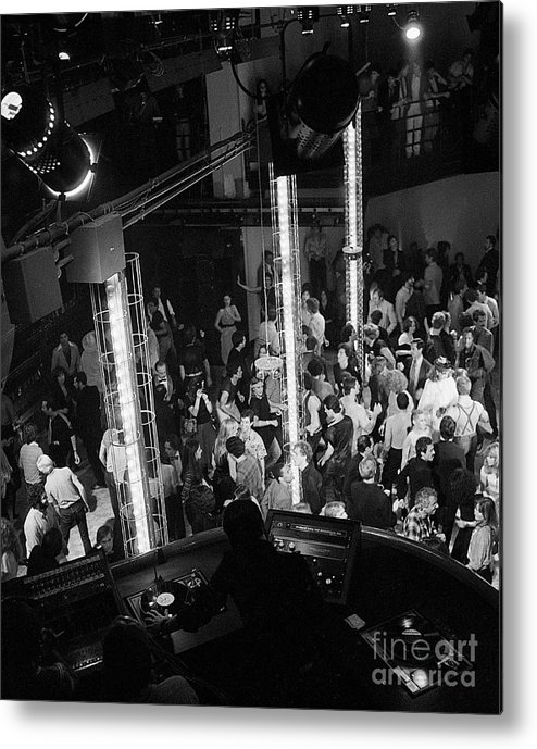 Crowd Of People Metal Print featuring the photograph People Dancing At Studio 54 by Bettmann