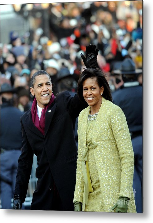 Inauguration Into Office Metal Print featuring the photograph President Barack Obama And First Lady by New York Daily News Archive