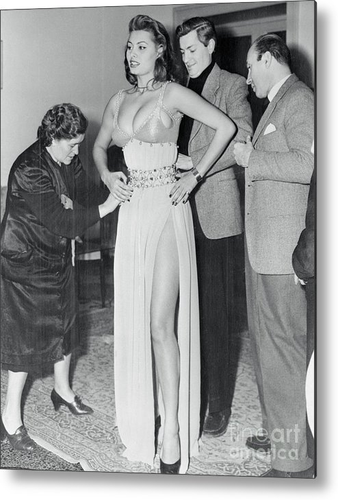 People Metal Print featuring the photograph Sophia Loren Being Helped To Dress by Bettmann