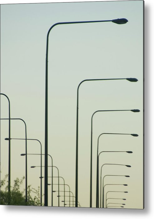 In A Row Metal Print featuring the photograph Streetlights Against Afternoon Sky by By Ken Ilio