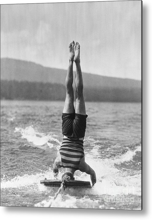 People Metal Print featuring the photograph Stunt Man Performing Aquaplane Feat by Bettmann