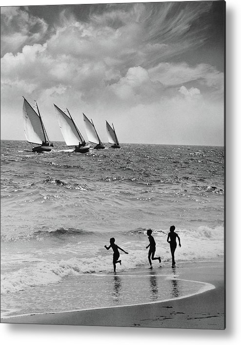 Following Metal Print featuring the photograph Three Boys Running Along Beach by Stockbyte