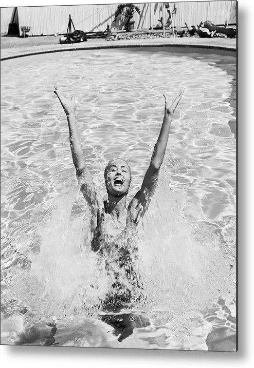 Human Arm Metal Print featuring the photograph Woman Having Fun In Swimming Pool by Tom Kelley Archive