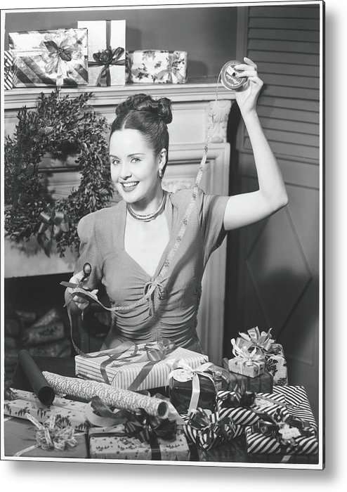 Human Arm Metal Print featuring the photograph Woman Wrapping Christmas Presents In by George Marks