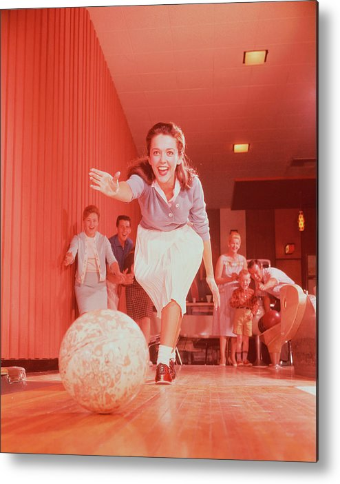 People Metal Print featuring the photograph Young Woman Bowling, Family Watching In by Fpg