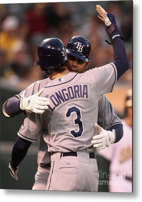 American League Baseball Metal Print featuring the photograph Carlos Pena and Evan Longoria by Jed Jacobsohn