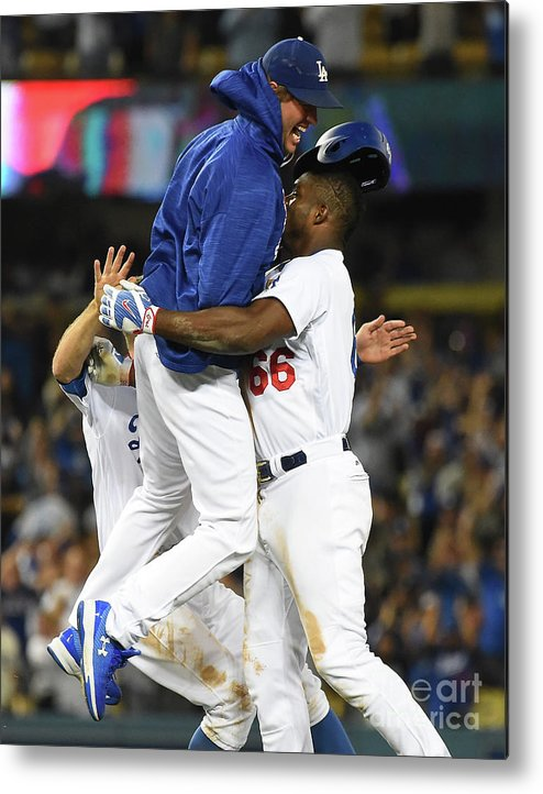 Ninth Inning Metal Print featuring the photograph Clayton Kershaw and Yasiel Puig by Jayne Kamin-oncea
