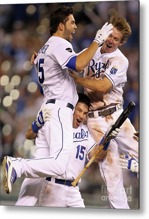 American League Baseball Metal Print featuring the photograph Eric Hosmer, Matt Treanor, and Chris Getz by Jamie Squire