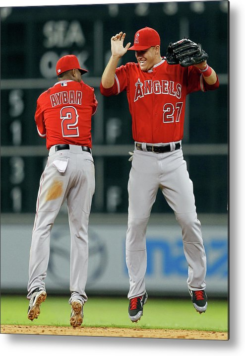 American League Baseball Metal Print featuring the photograph Erick Aybar and Mike Trout by Bob Levey