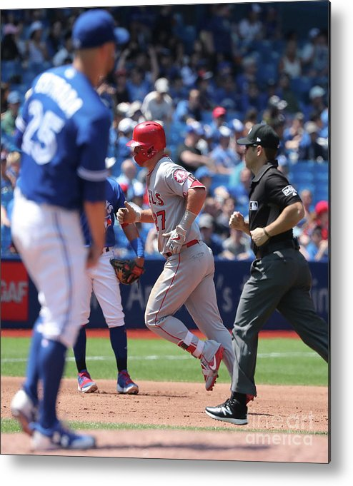 People Metal Print featuring the photograph Mike Trout and Marco Estrada by Tom Szczerbowski