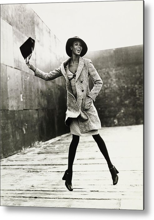 Black And White Metal Print featuring the photograph Naomi Campbell Jumping in the Air by Arthur Elgort