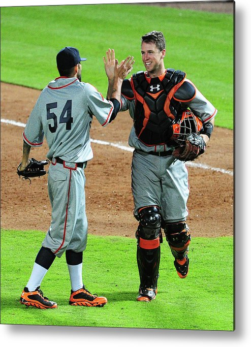 Atlanta Metal Print featuring the photograph Sergio Romo and Buster Posey by Scott Cunningham