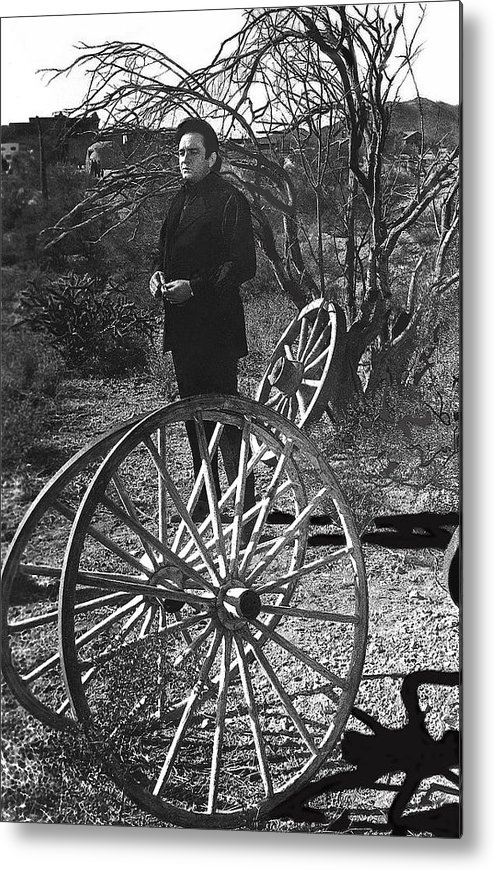 Johnny Cash Meditating Wagon Wheel Graveyard Old Tucson Az Black And White Metal Print featuring the photograph Johnny Cash Meditating Wagon Wheel Graveyard Old Tucson Arizona 1971 by David Lee Guss