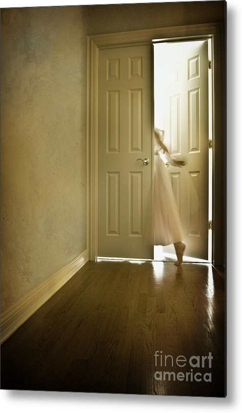 Memory; Woman; Female; Lady; Ghost; Caucasian; Dress; Pink; Flowing; Blur; Foot; Barefoot; Door; Doorway; Wood Floors; Closed; Open; Going Into The Light; Light; Bright; Heaven; Death; Wall; House; Home; Indoors; Inside; Hall; Foyer; Walking; Conceptual Metal Print featuring the photograph Entrance by Margie Hurwich