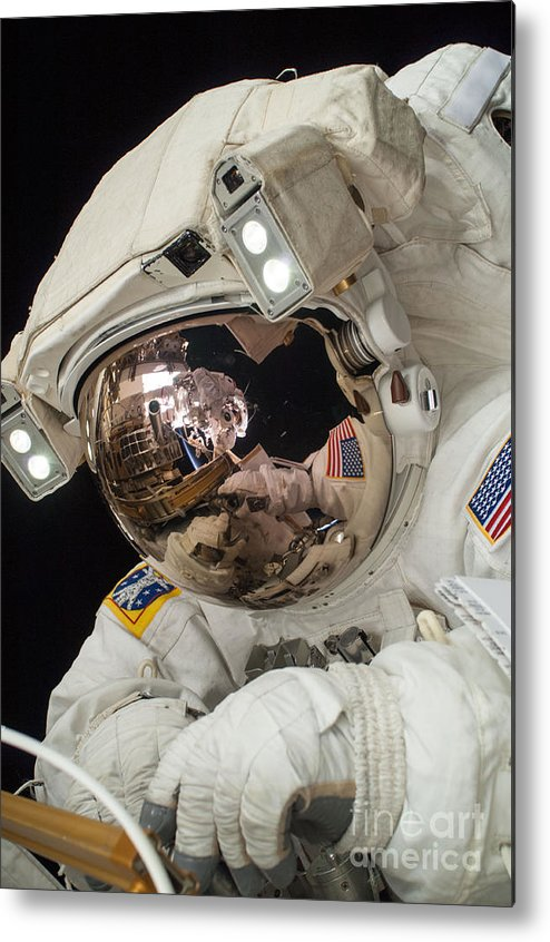 Space Metal Print featuring the photograph Iss Expedition 38 Spacewalk by Science Source