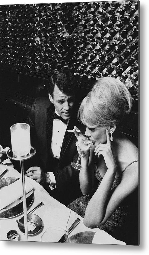 Architecture Metal Print featuring the photograph A Glamorous 1960s Couple Dining by Horn & Griner
