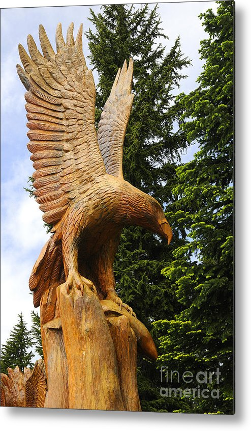 Grouse Metal Print featuring the photograph Chainsaw Carved Eagle by Brenda Kean