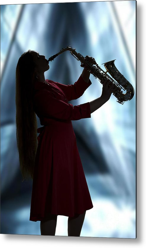 Saxophone Metal Print featuring the photograph Girl Musician Playing Saxophone In Silhouette Color 3353.02 by M K Miller