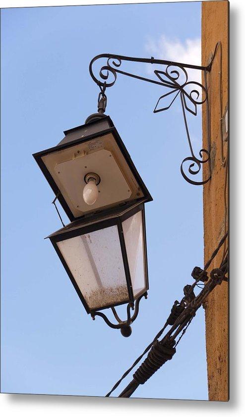 Lantern Metal Print featuring the photograph Hungry Street Light by Renato Sensibile