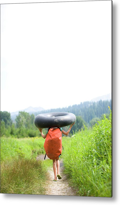 Anticipation Metal Print featuring the photograph Pre Teen Girl Carrying An Inner Tube by Woods Wheatcroft