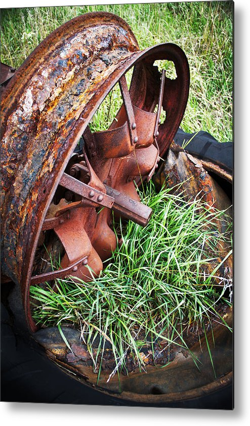 Tractor Metal Print featuring the photograph Ferrous Wheel by Guy Shultz