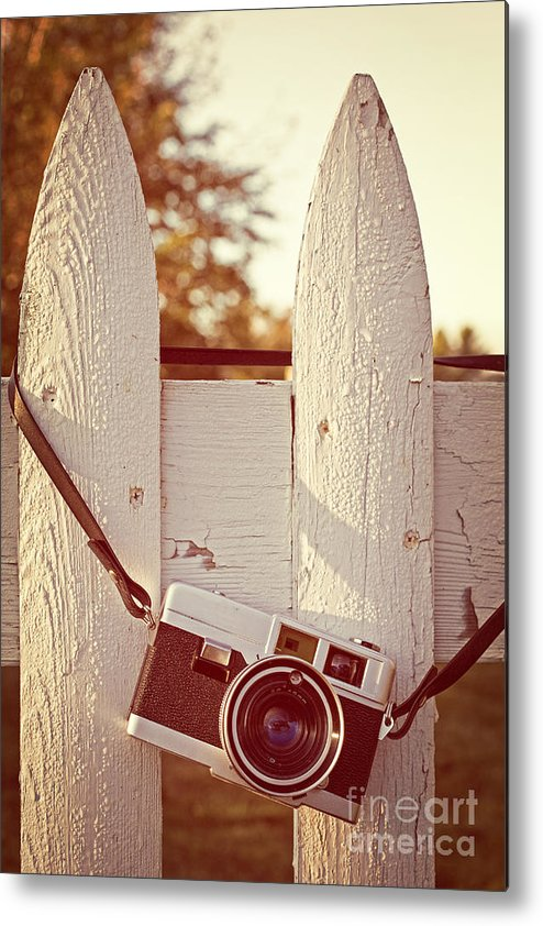 Sunrise Metal Print featuring the photograph Vintage Film Camera On Picket Fence by Edward Fielding